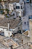 On the beautiful streets of summer Matera, Italy. MATERA, ITALY - AUGUST 27, 2018: Warm scenery summer day high angle close-up street view of amazing ancient royalty free stock images