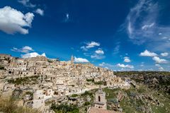 Wide panoramic cityscape view of Matera, Italy. MATERA, ITALY - AUGUST 27, 2018: Warm scenery summer day view of the amazing ancient town of the famous Sassi royalty free stock image