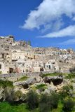 Matera in Italy. Matera (Southern Italy) has gained international fame for its ancient town, the Sassi di Matera (meaning stones of Matera). The Sassi, originate stock photo