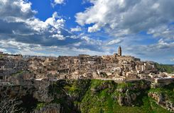 Matera in Italy. Matera (Southern Italy) has gained international fame for its ancient town, the Sassi di Matera (meaning stones of Matera). The Sassi, originate royalty free stock photos