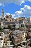 Matera in Italy. Matera (Southern Italy) has gained international fame for its ancient town, the Sassi di Matera (meaning stones of Matera). The Sassi, originate stock images