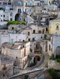 Matera in Italy. Matera (Southern Italy) has gained international fame for its ancient town, the Sassi di Matera (meaning stones of Matera). The Sassi, originate Royalty Free Stock Photo