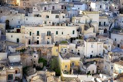Matera Italy. Matera (Southern Italy) has gained international fame for its ancient town, the Sassi di Matera (meaning stones of Matera). The Sassi, originate Royalty Free Stock Image