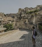 Matera street city Italy. Square sky windows cloud tower colors country road street courts green door panorama sunset courts sleep square Italy Stock Image