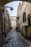 Matera street city Italy. Square sky windows cloud tower colors country road street courts green door panorama sunset courts sleep square Italy Royalty Free Stock Image