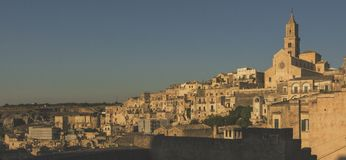 Matera street city Italy. Square sky windows cloud tower colors country road street courts green door panorama sunset courts sleep square Italy Stock Photography