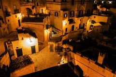 Matera street city Italy. Square sky windows cloud tower colors country road street courts green door panorama sunset courts sleep square Italy Stock Photo