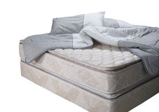 Materasso del letto con il cuscino e la coperta Immagini Stock