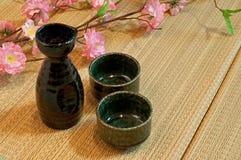 Materasso di Tatami e bottiglia di causa Immagine Stock