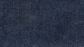 Materia textil de la tela del fondo del material de los vaqueros foto de archivo libre de regalías
