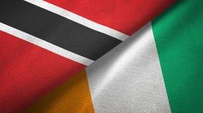 Materia textil de las banderas de Costa de Marfil dos de Trinidad and Tobago y de Cote d ?Ivoire libre illustration