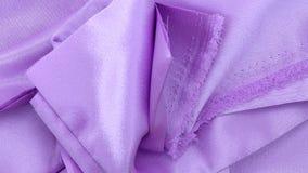 Materia textil del satén de la lila Imagen de archivo