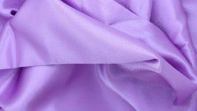Materia textil del satén de la lila Foto de archivo libre de regalías