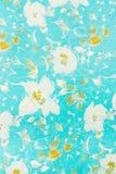Materia textil, flores en una turquesa pálida Imagenes de archivo