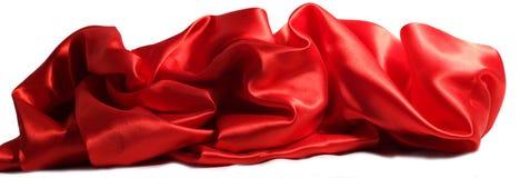 Materia textil ondulada roja que miente en el fondo blanco Imagen de archivo libre de regalías