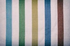 Materia textil rayada colorida como fondo o textura Imagen de archivo libre de regalías
