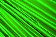 Materia textil verde del satén, interior moderno, Foto de archivo