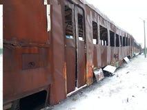 Materiaal na rampen en militaire operatie De brandwond van de passagierstrein uit Retro vervoer Weersomstandigheden royalty-vrije stock foto