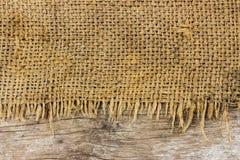 Material áspero del saco y textura de madera Imágenes de archivo libres de regalías