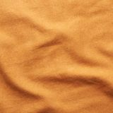 Material anaranjado del paño Foto de archivo libre de regalías
