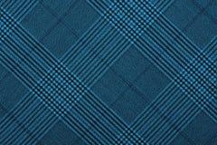 Material azul em testes padrões geométricos, um fundo Fotos de Stock