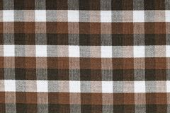 Material into brown grid, a background Royalty Free Stock Photography