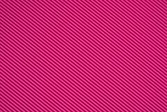 Material cor-de-rosa com uma superfície com nervuras Imagens de Stock