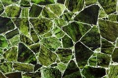 Material de piedra natural superior verde oscuro con los modelos maravillosos fotografía de archivo libre de regalías