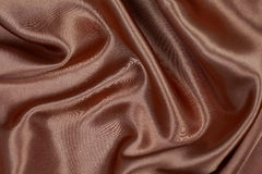 Material de seda o papel pintado elegante del terciopelo del satén de la textura de Brown Foto de archivo