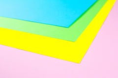 Material design yellow, blue, pink and green paper background. Photo. Royalty Free Stock Photos