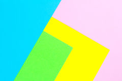 Material design yellow, blue, pink and green paper background. Photo. Royalty Free Stock Photo