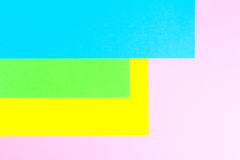 Material design yellow, blue, pink and green paper background. Photo. Royalty Free Stock Image
