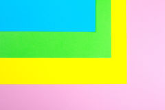 Material design yellow, blue, pink and green paper background. Photo. Royalty Free Stock Photography