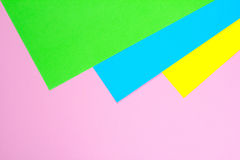 Material design yellow, blue, pink and green paper background. Photo. Stock Photos
