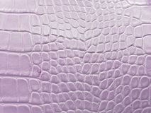 approach to leather surface in light purple color, background and texture royalty free stock photo