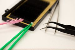 Material för ögonfransförlängning Borstar tillbehör för ögonfransförlängningar royaltyfria foton