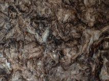 Material för konstgjord plan för utfyllnadsgods för texturbakgrundsfiber beige färgrikt grått mjuk luddig varm signal för färg Arkivfoton