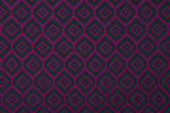 Material in geometric patterns, a textile background. Royalty Free Stock Image