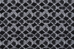 Material in geometric patterns, a textile background. Royalty Free Stock Photo