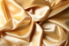 Material with a gold tint. An abstract picture of a material with a gold tint Royalty Free Stock Photos
