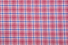 Material into grid, a textile background Royalty Free Stock Photo