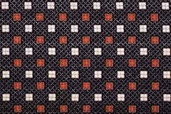 Material nos quadrados, um fundo Foto de Stock Royalty Free