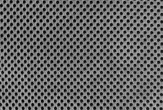 Material poriferous poroso respirable gris para la ventilación del aire con los agujeros Textura de nylon de la ropa de deportes  imagen de archivo