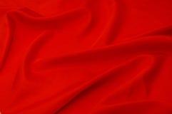 Material rojo de la seda de la textura Fotos de archivo