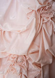 A pink wedding dress with floral detail Stock Images