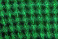 Material into small, green grid, background Stock Image