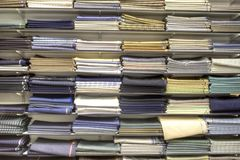 Material stacked on shelves. Lots of material folded and stacked on shelves Royalty Free Stock Photo