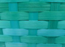 Woven surface with vegetable fibers painted in aquamarine, background and texture. Material and style used in mexican crafts, made with dry palm stock photography