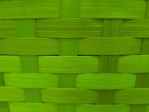 Woven surface with vegetable fibers painted in green, background and texture. Material and style used in mexican crafts, made with dry palm royalty free stock image