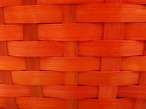 Woven surface with vegetable fibers painted in red, background and texture. Material and style used in mexican crafts, made with dry palm stock photography
